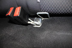 locate the bolts securing the adult buckles